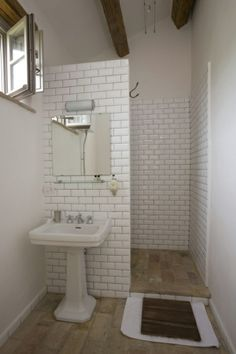 Like the sink against the shower wall. Keeps the plumbing close & space saver in small bathroom.