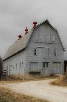 An old grey barn with crimson cupolas. Still a handsome old structure.