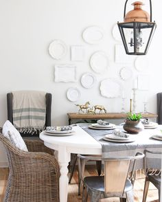 This room is still one of my favorites. It came together over time, as some of the most unique rooms do. A second hand table painted white, a mix of chairs, inexpensive plates and an outdoor lantern. Share your own inspired room! I'll be looking for rooms to feature! Use my hashtag #myinspiredroom want to know how to hang plates? Here's a post and video with what I use > link in profile http://theinspiredroom.net/2015/11/05/how-to-hang-plates-platters-bowls-on-a-wall-video/