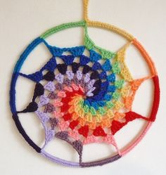 String Theory Crochet shares a free tutorial for crocheting this Rainbow Spiral Dream Catcher. Click through the link for the tutorial. Instructions say this is good for using up little leftover bits of yarn.
