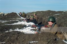 Chechen soldiers take positions in a trench next to a road leading to Grozny on December 10, 1994 as Russian troops advance closer to the capital of the breakaway republic of Chechnya. At least 200 Russian armored vehicles were reportedly heading on December 11, 1994 towards the Chechnya capital of Grozny from the west of the republic.
