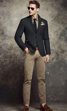 A smart casual combination of a black wool blazer jacket and camel chinos can maintain its relevance in many different circumstances. Why not introduce brown suede tassel loafers to the mix for an added touch of style? Shop this look on Lookastic: https://lookastic.com/men/looks/blazer-dress-shirt-chinos/15813 — Dark Brown Sunglasses — Olive Dress Shirt — Navy Tie — Beige Print Pocket Square — Black Wool Blazer — Brown Leather Belt — Dark Brown Leather Watch — Khaki Chinos — Brow...