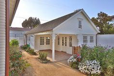 A large detached three-car garage that is naturally lit with  windows and two sky-lights. It has its own covered patio and office/garden area, and additional storage in the attic area. Napa Farmhouse in Manhattan Beach #Napa #Farmhouse #ManhattanBeach #newoldhouse
