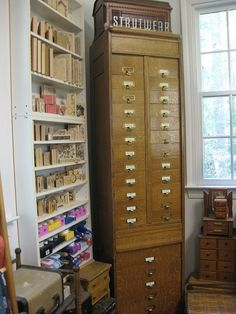 Collage Candy: Where this blogger creates! Postal forms cabinet, the shelves are actually roll ups.