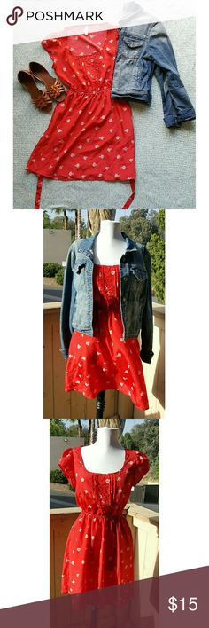 """🆕 Xhiliration Red Print Dress M Description: Short dress with pockets and waist tie Color: Red with white bicycle print ✅EUC: No Tears, Stains, Marks  🆕Smoke Free Home ⓂMeasurementsⓂ   - Length: 26""""   - Width (armpit to armpit): 13""""   - Waist: 8.5"""" cinched elastic waist  **Please note, I record all shipping to ensure you receive the correct items listed in their described conditions Xhilaration Dresses Mini"""
