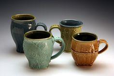 three pottery mugs handmade