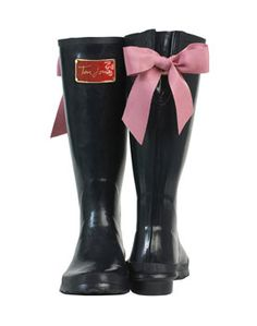 Black galoshes with a pink bow