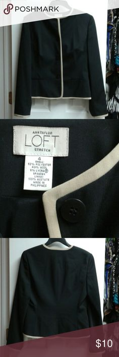 AnnTaylor Loft stretch blazer This versatile black blazer has a beige edging. Princess seams and bust darts create a flattering fit. 22 inches from shoulder to hem, and 18 inches across the bust when buttoned. Gently worn 2-3 times, the pockets at the hip are still sewn shut. LOFT Jackets & Coats Blazers