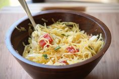 Skinny Spaghetti (squash) with olive oil, parm cheese, diced tomatoes, basil, onions, salt and pepper.