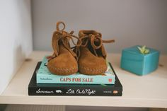 Infant Fringe Booties are seen in a Modern boy's nursery via 100 Layer Cakelet
