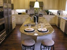 This U-shaped custom kitchen island design features a large island counter with a second sink and bar seating.