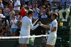 Milos Raonic greets Daniel Gimeno-Traver at the net following their First round match. Eddie Keogh/AELTC Wimbledon 2015