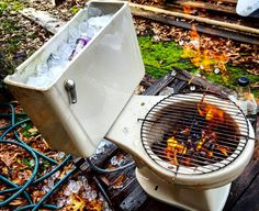 Upcycled toilet BBQ. Fire sanitizes.