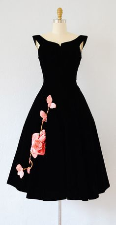 I could do without the flower... The cut is amazing!  vintage 1950s dress | vintage 50s velvet dress #1950s #50sdress #vintage