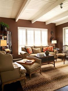 Brown cream tan living room color palette. Think the walls are too dark for me but I love that rug!!