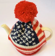 This is the knitting pattern for an american flag tea cosy. Worked in Aran weight (worsted) yarn it has embroidered stars. Materials Use an Aran weight (US Worsted) yarn that has a knit tension of 18 sts and 25 rows over stocking stitch on 5 mm (UK/Canada/Aus no.6, US no.8) needles. I used King Cole Merino Blend Aran (80m/88yds per 50g ball), 1 x 50g ball each of shades 9 Scarlet, 776 Aran (you need approx 1/2 ball), and 769 Navy (you need approx 1/4 ball). Siz...