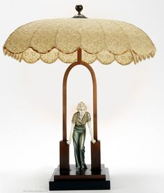 """An Art Deco chryselephantine (cold-painted bronze with ivory) lamp """"The stile"""" with original shade, Ferdinand Preiss, Berlin 1930s."""