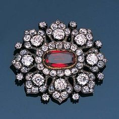 A late 19th century spinel and diamond brooch/pendant,
