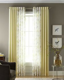pairing a rich solid curtain and printed sheer on one curtain rod creates the illusion living room