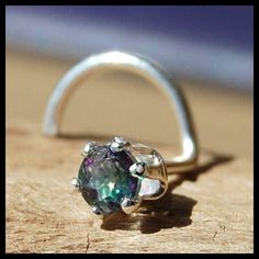 Nose Stud Mystic Topaz and Sterling Claw Set - CUSTOMIZE from RockYourNose on Etsy. Saved to Piercings!. #want #green #spiral #stud #nose #piercings #jewelry #nosestud.