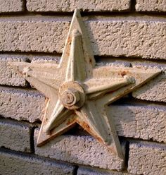 A look into the use and restoration of decorative masonry anchors on brick buildings in New York City. A cast iron masonry, or architectural, star. Concrete Anchors, Masonry Wall, Wall Anchors, Brick Building, Man Stuff, Cast Iron, Restoration, Porch, Buildings
