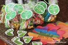 St. Patrick's Day crafts: printable treat bag tags; leprehaun footprints painted with your fist; rainbow hunt shamrocks.