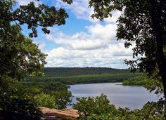 Okmulgee State Park - Oklahoma =  native sandstone structures, campgrounds, boat ramps, pavilions, playground, fishing dock, swimming beach, fishing, water sports, hiking, waterskiing