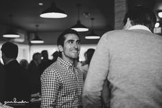 A candid photograph of guests talking during a rehearsal dinner in Nantucket Gina Brocker Photography