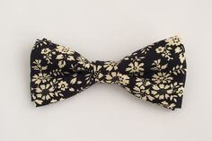 Men's bow ties are fitted with a cotton twill adjustable strap Kids bow ties are clip on Pre-tied.