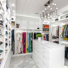 A dreamy walk-in closet full of class and sophistication. Color us #greenwithenvy! #Top10DesignOf2015 #manchesterwarehouse