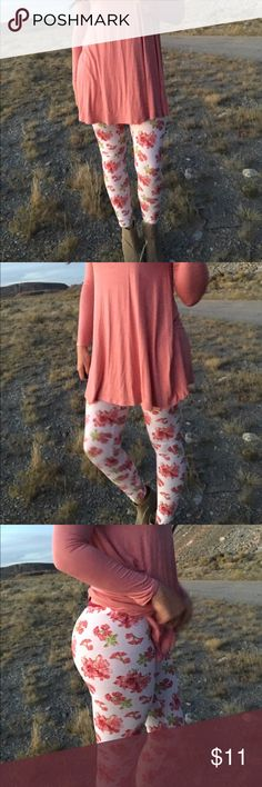 << Pink Floral Leggings >> So cute and so bright! A beautiful blend of colors that stand out in a crowd! Fit true to size, I'm a large size 8/10 and am wearing the large. 95% cotton 5% Spandex Pants Leggings