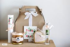 Wedding welcome gift box for the out-of-town guests. Scented candle, mastic liquor, cookie and city info.