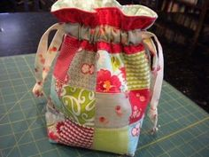 Quilted GIFT bag -- A great beginner quilt project with tutorial from A Quilting Life | Great for a travel bag, makeup, kid's toys #quilt #giftbag #DIY