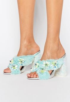 'Cause the general wisdom is that every woman should have a pair of really, ridiculous shoes. Let us introduce you to yours, there to tickle your toes at your BFF's wedding and beyond.