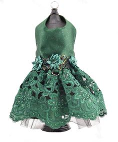This dog dress is stunning! Sparkle Satin top with a built in harness, Gorgeous beaded flower trim at the waist, and beaded lace skirt with lots of tulle to hold it out. Amazing! Your fur-girl will be