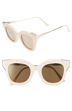 Dramatically bold cat-eye sunglasses with a hand-polished finish go super-sleek and modern with slender metal temples.