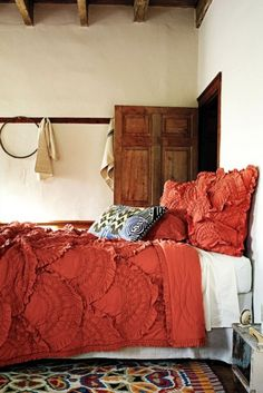 i love the simple walls+rafters+hook rack. the colour of the bedspread is lovely as is the rug. sanctuary indeed.