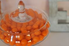 Display colorful gumballs in a glass container   Modern decor and a snack!