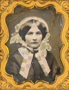 1/9 Plate daguerreotype of a young lady wearing a plaid tinted bonnet