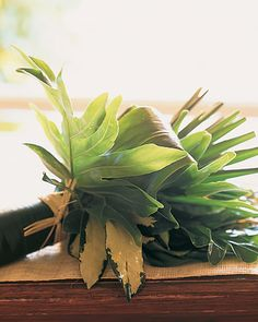 For a tropical destination wedding, opt for a bouquet of lush leaves in varying shades of green and different textures