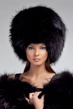 """When you don't dress like everybody else, you don't have to think like everybody else."" HUGE fox fur hat! TB"
