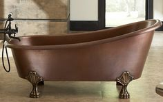 Luxurious Tubs -  The Heisenberg Soaking Bathtub by Sinkology is certainly one of the most unique bathtubs around.  At first, your attention will be grabbed by its copper finish and meticulously hand-cast solid bronze feet – both of which will certainly make a statement in any home. It may be luxurious, but it's practical too and has a pre-drilled 2.5'' standard overflow hole, while also being completely maintenance free. Find out more.