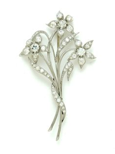 PLATINUM AND DIAMOND BROOCH. European, early 20th century. Platinum floral motif containing old mine cut diamonds approx. 2.00ct tw. Sold at Garth's Auctions on December 9, 2015 for $1,320.