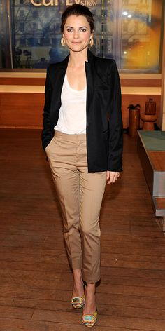 Keri Russell in white shirt, black tailored blazer, and cropped khaki trousers