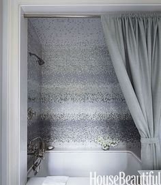 In a New York City bathroom designed by Sandra Nunnerley, mist mosaic tile by Studium has a watery, pearlescent glow.
