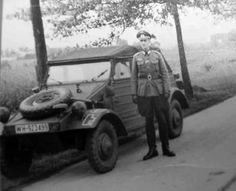 A typical VW Kübelwagen and a German Officer on a field road.