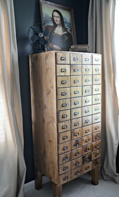 This card catalogue is actually a cabinet with shelves.  The function is amazing, and the stain is SOOOO beautiful!