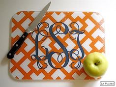 Monogram cutting board- great gift idea for a holidays or even newly weds. This would be very easy to do on the backside of a cutting board with fabric or scrapbook paper or print something out from the computer. I just had a thought that a family pic or wedding pic might be cute too and then Modge podge it or seal it. Love the possibilities here!