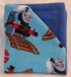 Check out this item in my Etsy shop https://www.etsy.com/listing/210209278/thomas-the-train-fleece-snuggie-baby