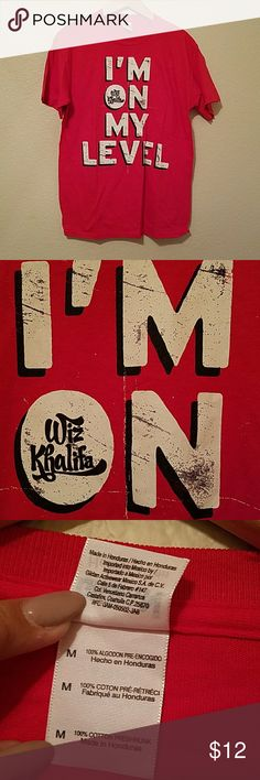 WIZ KHALIFA T SHIRT I'M ON MY LEVEL I'M ON MY LEVEL T-SHIRTSHORT SLEEVET-SHIRT  8 OZ 100% COTTON TUBULAR JERSEY. CLASSIC FIT SCREEN PRINT   SIZE MEDIUM & EASY FIT   This style comes in a regular fit which fits true to size.  CARE Machine wash under 40 degrees, Do not Iron on Print & wash according to instructions on care label  BRAND NEW WITH OUT TAGS WAS BOUGHT 2013 NEVER WORN WIZ KHALIFA Tops Tees - Short Sleeve
